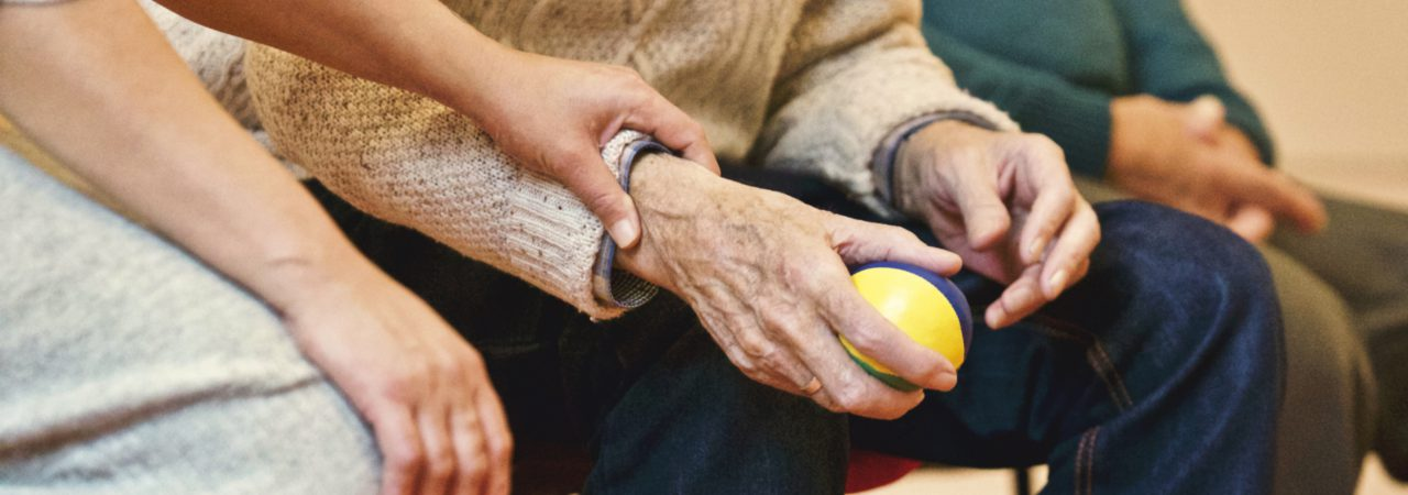 Elderly patient with stress ball